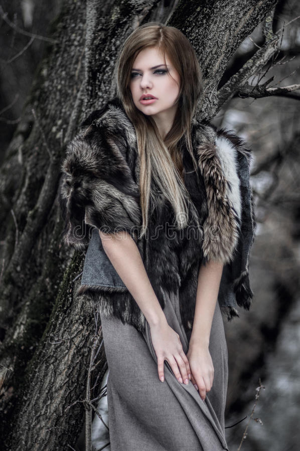 young girl in grey fur cape royalty free stock photos