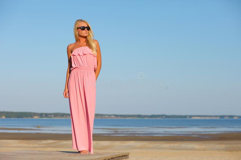 Girl in dress and sunglasses on background of sky royalty free stock photos