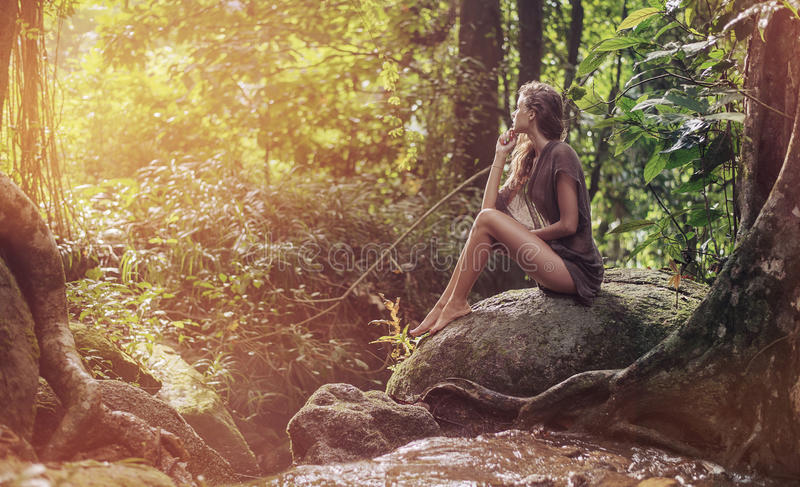 young lady resting in the tropical forest stock images
