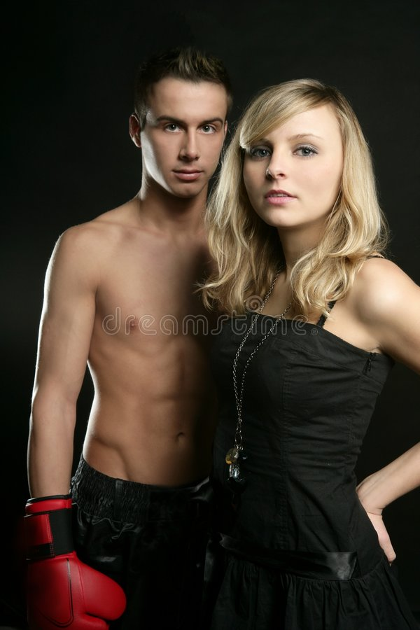 young male boxer with blond beautiful girl royalty free stock image