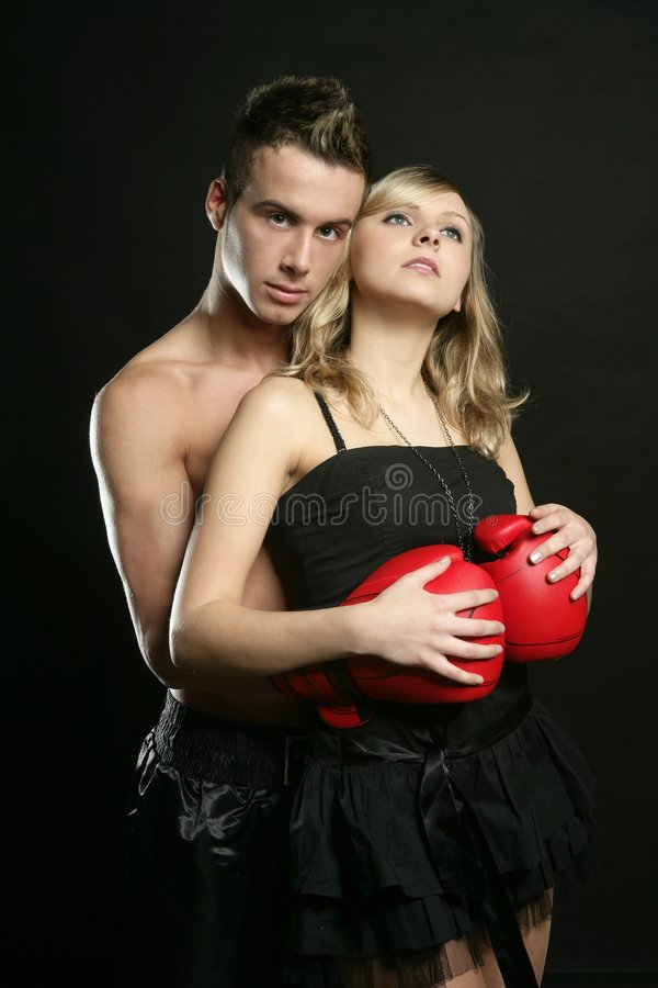 young male boxer with blond beautiful girl stock photo