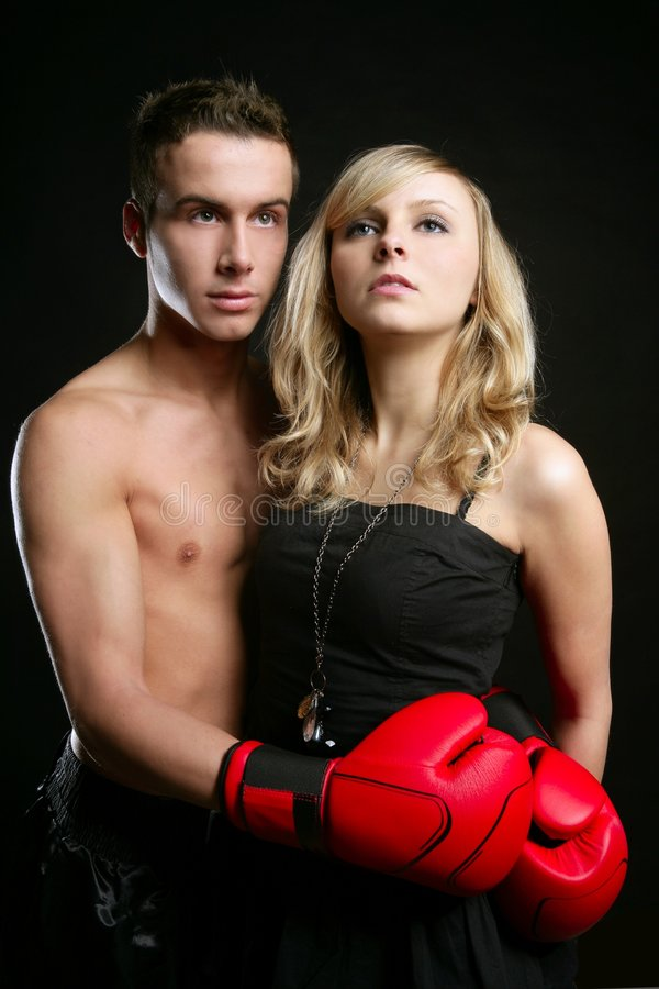young male boxer with blond beautiful girl royalty free stock photography