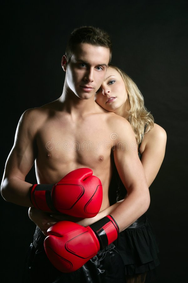young male boxer with blond beautiful girl stock image