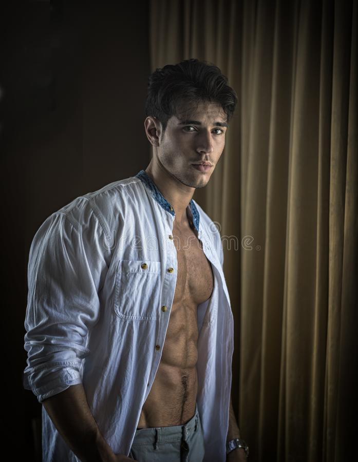 Free Sexy Young Man Dressing By Window Curtains Stock Image - 146704671