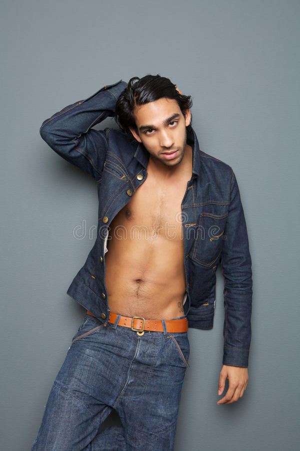 young man with open shirt stock photography