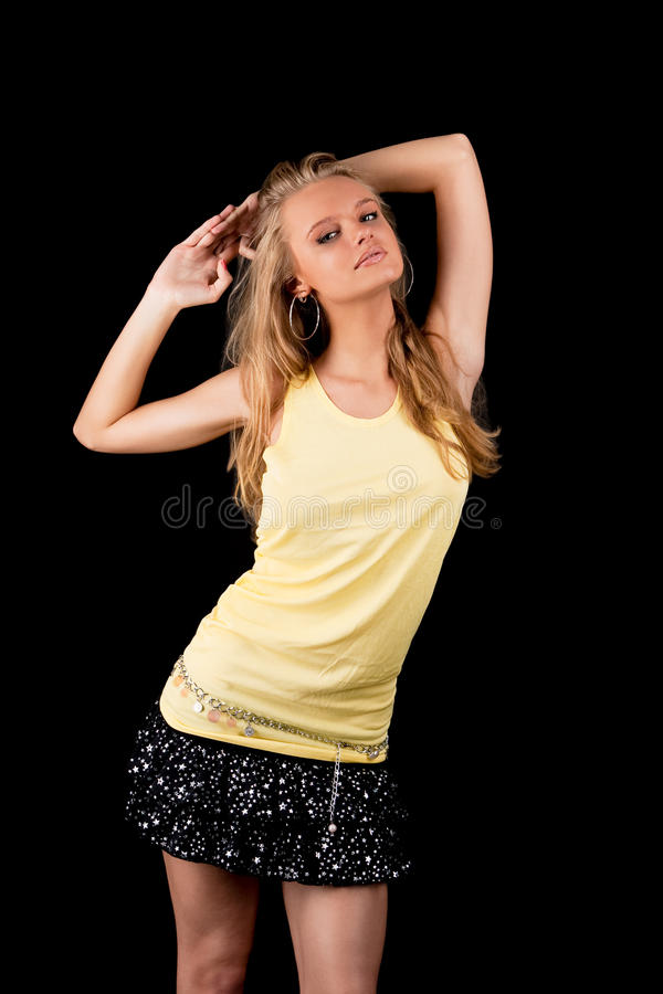 young pretty blonde girl with lifted hands stock image
