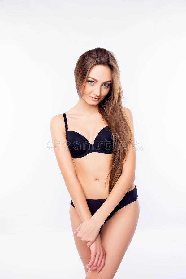 Free Sexy Young Pretty Woman In Black Lingerie Standing On A White Background Royalty Free Stock Image - 166268146