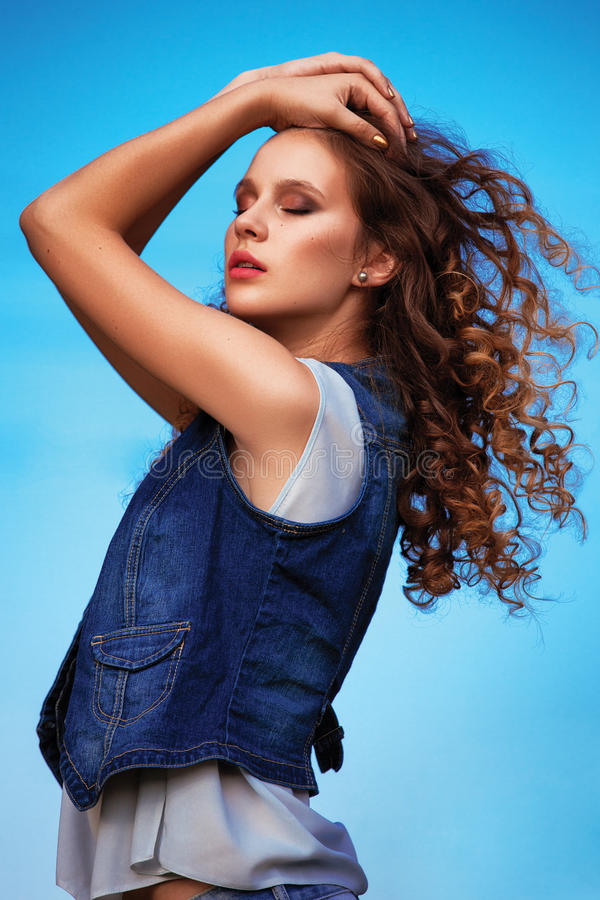 young stylish woman girl with flying elevated hair in air stock images