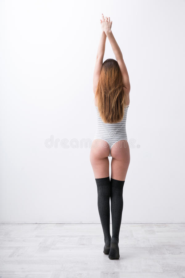 young woman in bodysuit royalty free stock images