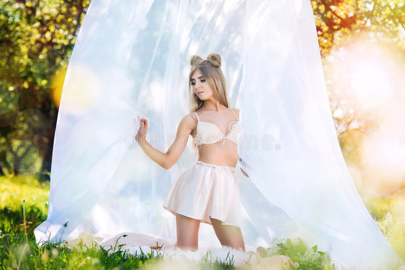 Young woman in bra and mini skirt outdoor.  royalty free stock image