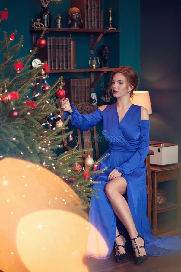 Woman celebrating christmas royalty free stock photography