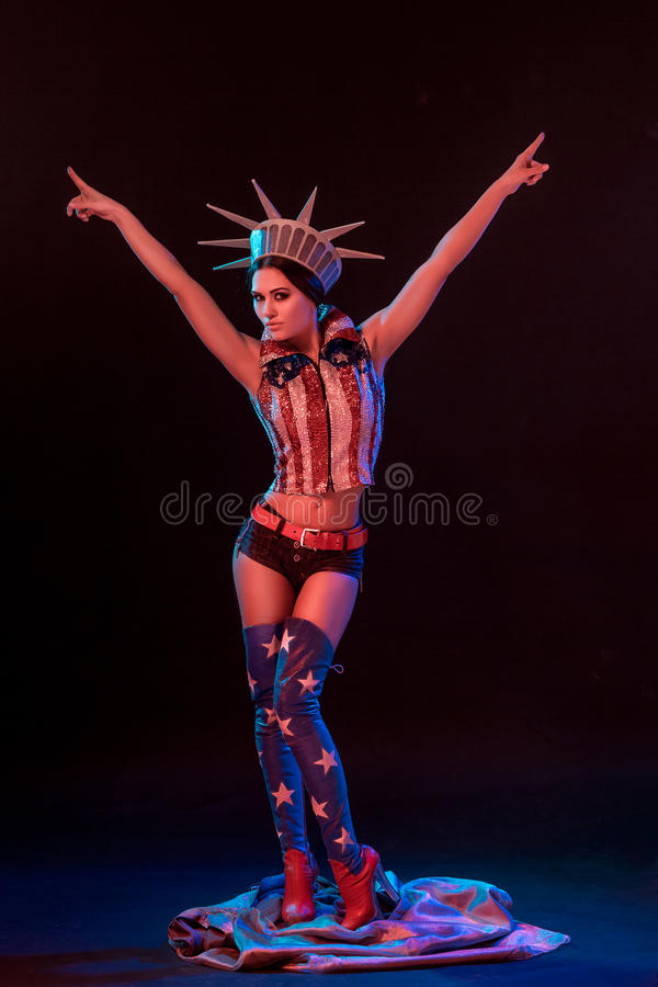 young woman in erotic fetish wear dancing striptease in nightclub. Nude woman in Show suit. stock image