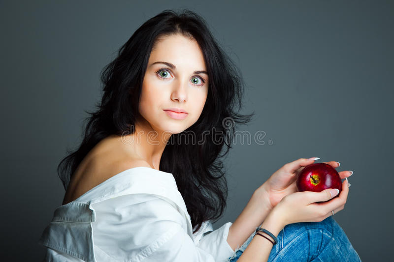Download Young Woman With Fresh Red Apple Stock Image - Image of eating, look: 21730693