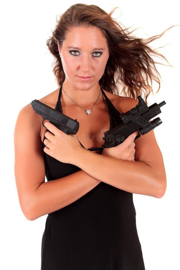 young woman gun stock photography