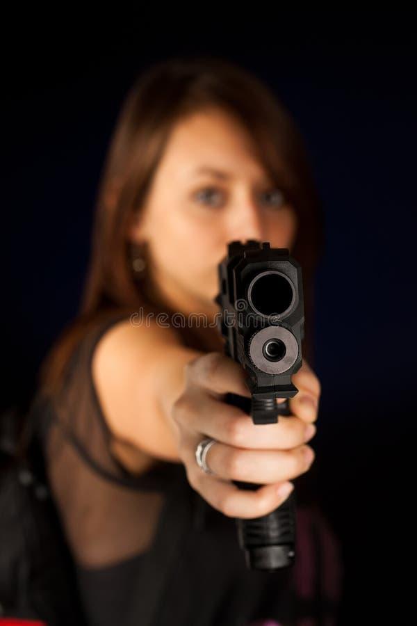 young woman with a gun stock photos