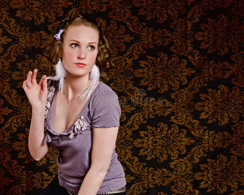 Young Woman Holding Her Feather Royalty Free Stock Image