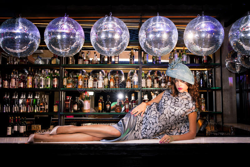 young woman lying on the bar at a night disco club stock photography