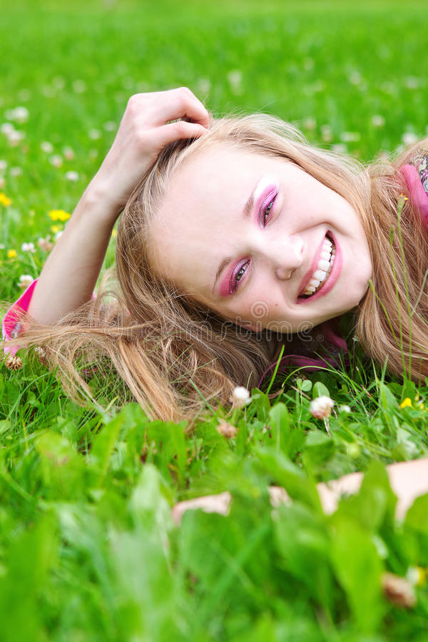 young woman in meadow stock images