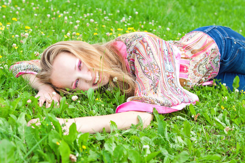 young woman in a meadow stock photos