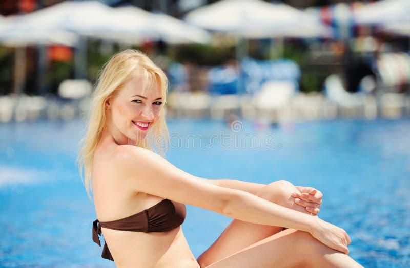 sexy young woman near swimming pool stock photo