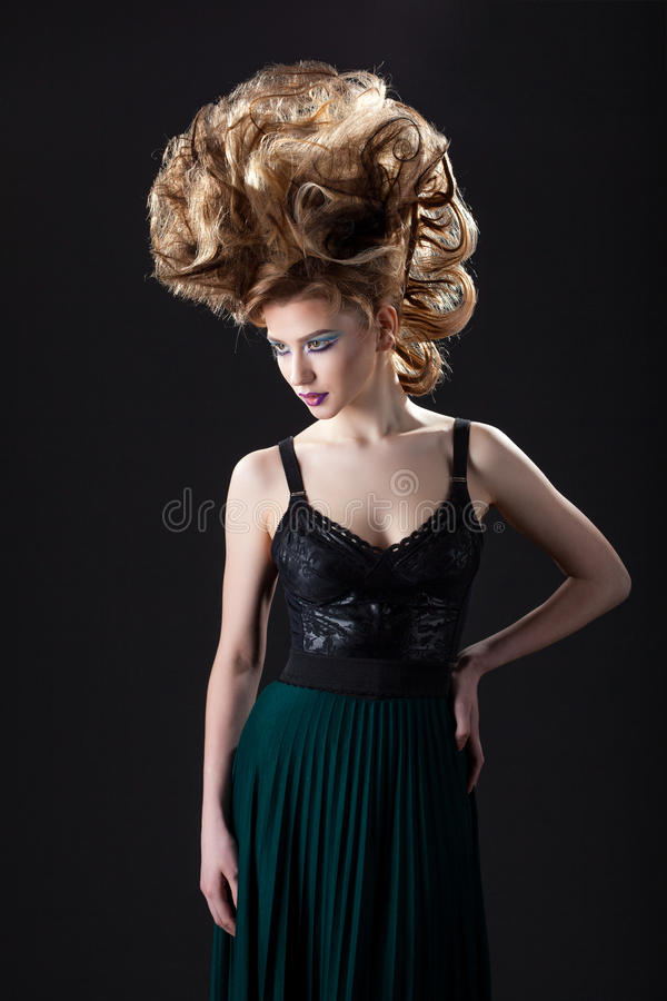 young woman posing with creative hairstyle stock photos