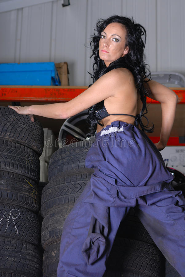Download Young Woman Posing On Tyres Stock Photo - Image: 15756432