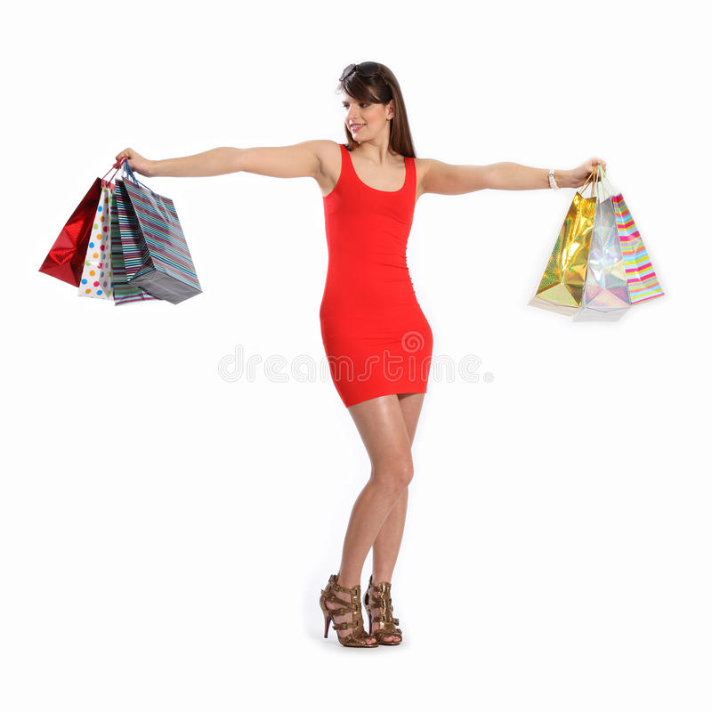 Download Young Woman In Red Dress With Shopping Bags Stock Image - Image: 18510759