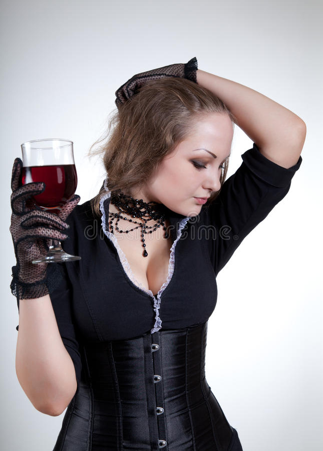 young woman with red wine stock image