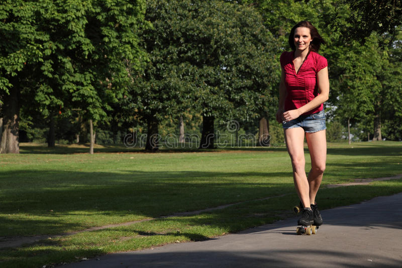 Download Young Woman Roller Skating In Park Sunshine Stock Photo - Image: 20361754
