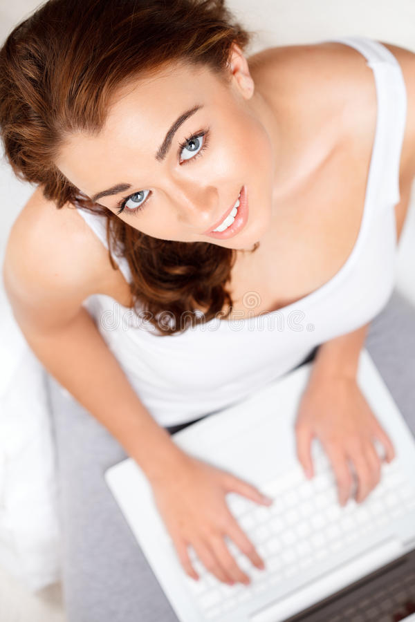 Download Young woman using a laptop stock image. Image of female - 26045853