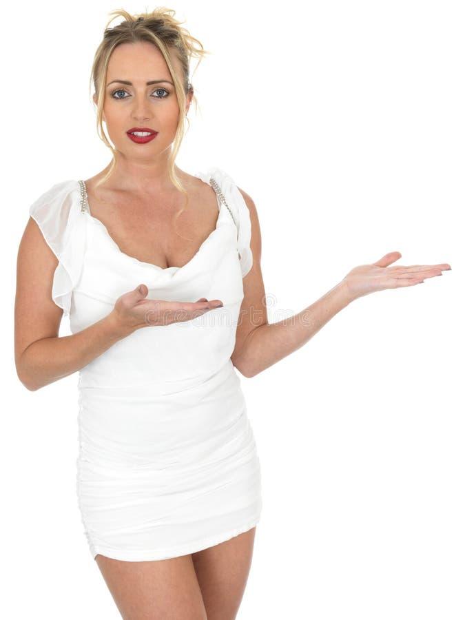 Young Woman Wearing Short White Dress Looking at Camera royalty free stock image