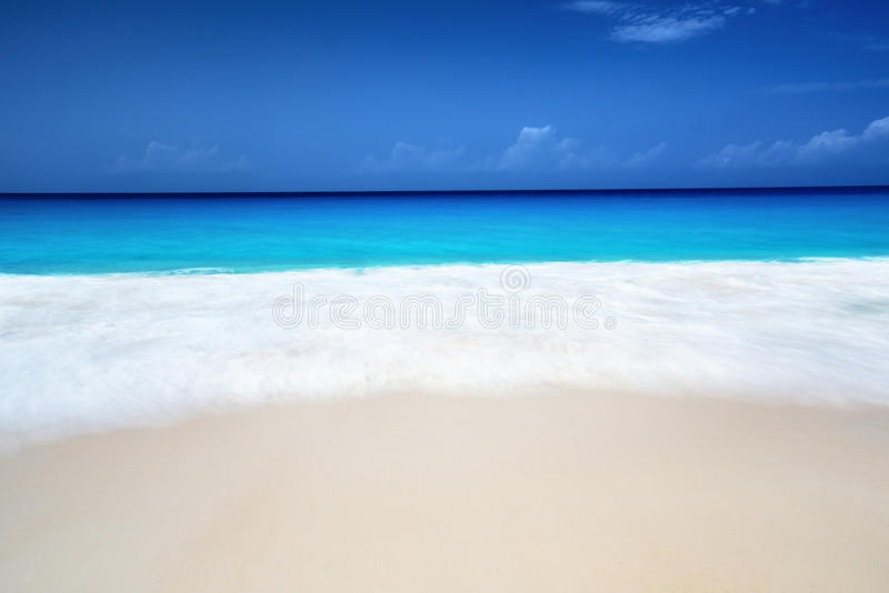 Seychelles beach in sunny day, long exposure blur royalty free stock image