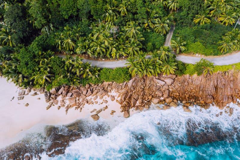 Seychelles Mahe island aerial drone landscape of coastline. Road along coastline of paradise sandy beach with palm trees stock image