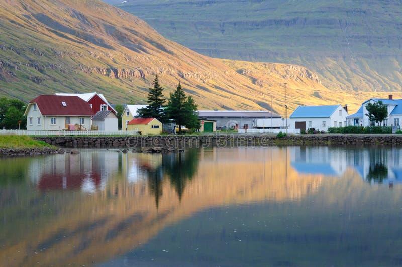 Seydisfjordur town Reflection. Morning reflection in Seydisfjordur town of Iceland royalty free stock photo