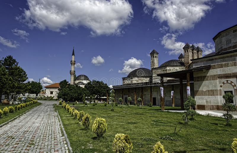 Historical Buildings in a green landscape with blue sky and fluffy clouds. Seyyid Sultan Şücaaddin Veli Külliyesi, Aslanbeyli Köyü, Seyitgazi stock photography