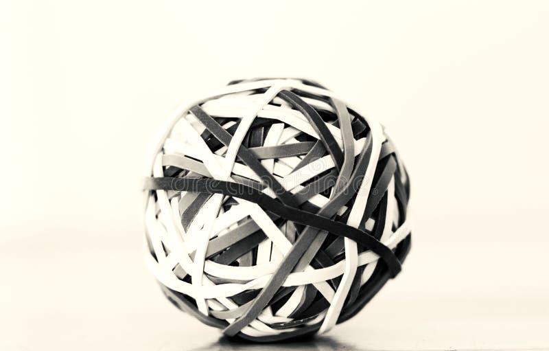Sfärisk rund gummibandboll i svartvitt royaltyfria foton