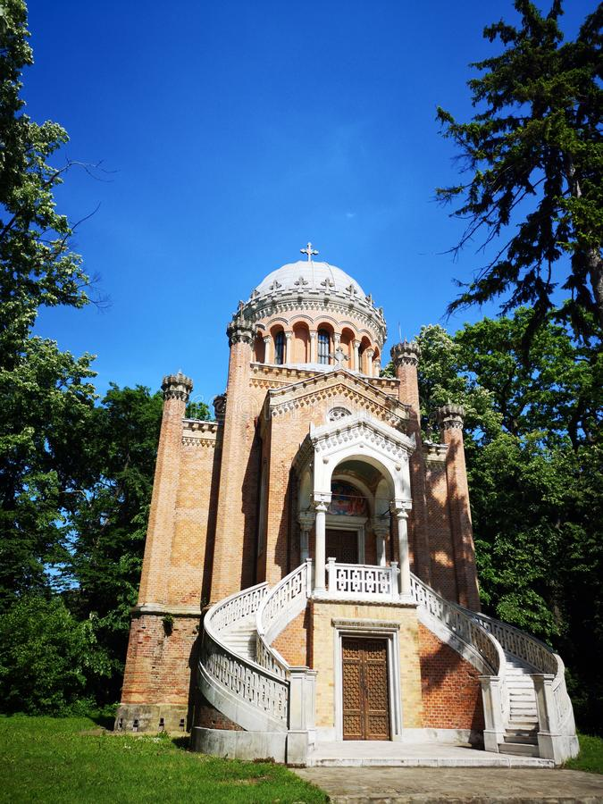Sfanta Treime Chapel  in Buftea. Sfanta Treime Chapel at the Stirbey Palace, in Buftea - Romania - has a gothic architecture and by the decorative paintings made royalty free stock photos