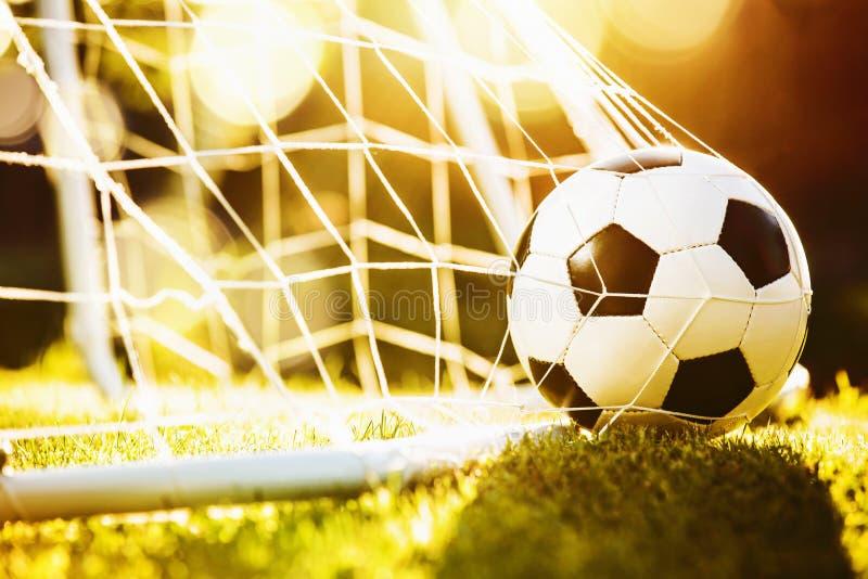 Sfera di calcio nell'obiettivo immagine stock libera da diritti