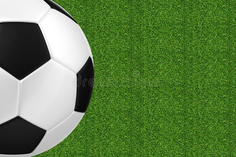 Sfera di calcio sopra erba verde immagini stock