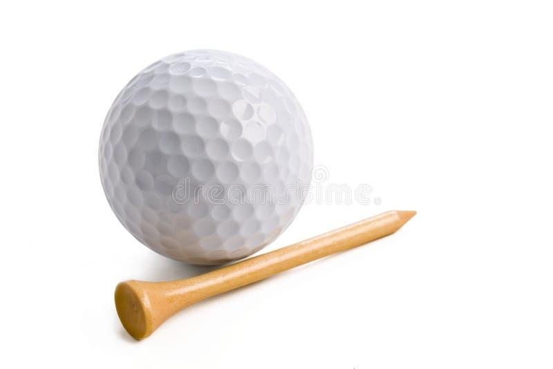 Sfera di golf con il T su bianco fotografie stock libere da diritti