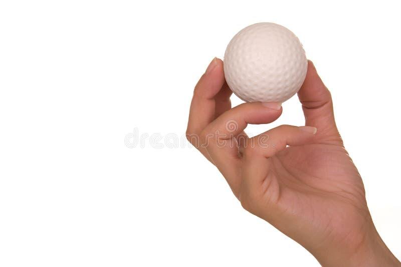 Sfera di golf della holding della mano fotografie stock