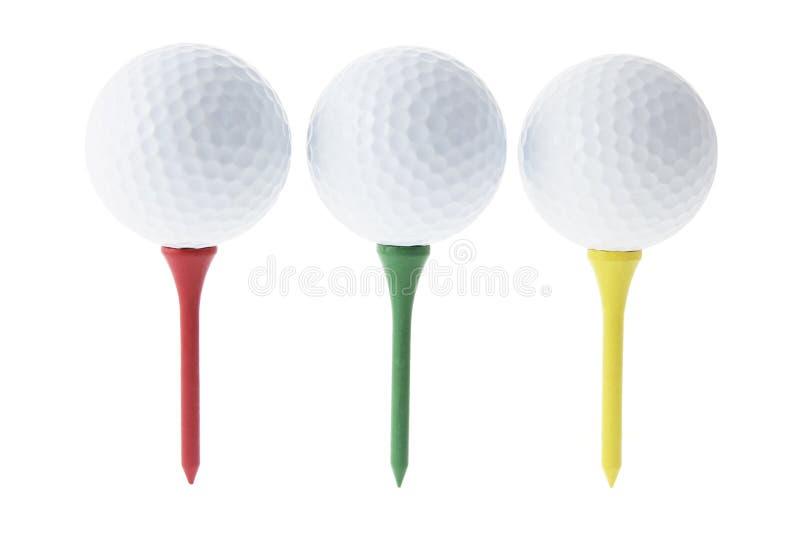 Sfere di golf sui T immagine stock