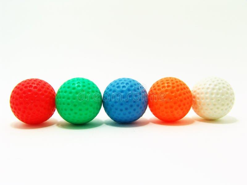 Sfere di golf variopinte immagini stock