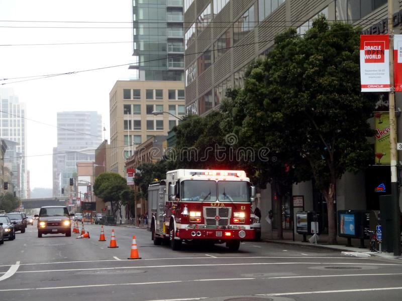 SFFD Red Firetruck drives down street in the rain royalty free stock photos