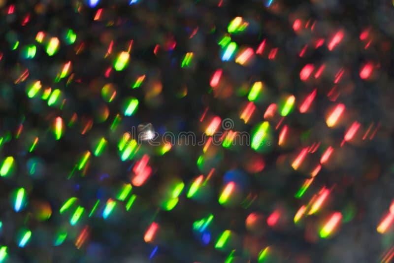 Sfondo astratto Glitter rosso e verde colore saturato, sfocato, macro Sequenze in caduta e scintilla fotografia stock libera da diritti