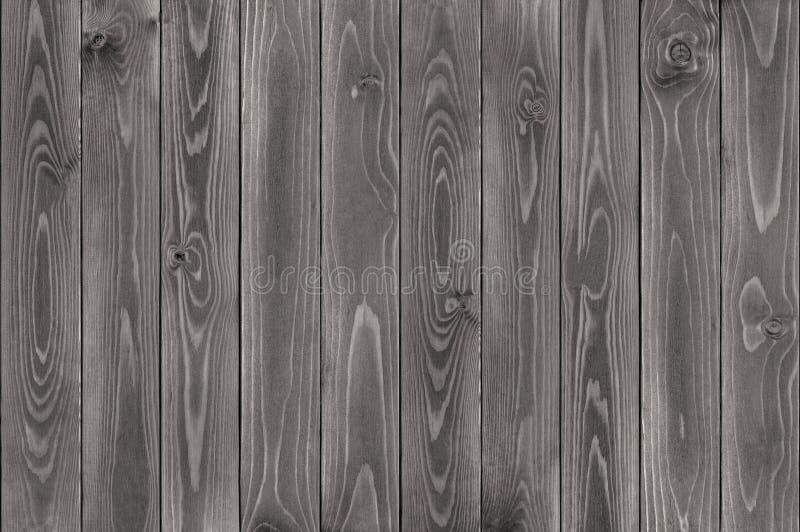 Sfondo naturale dei bordi scuri di legno della plancia verticali fotografia stock