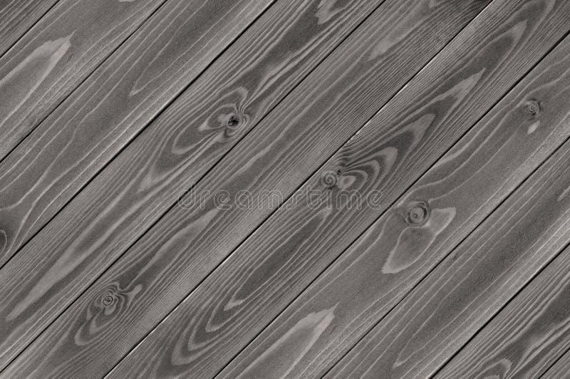 Sfondo naturale della diagonale scura di legno dei bordi della plancia fotografia stock