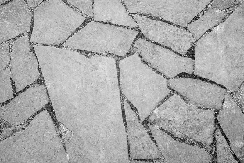 Sfondo naturale Struttura di una parete di pietra o di una roccia incrinata, nel complesso struttura Struttura orizzontale fotografia stock libera da diritti