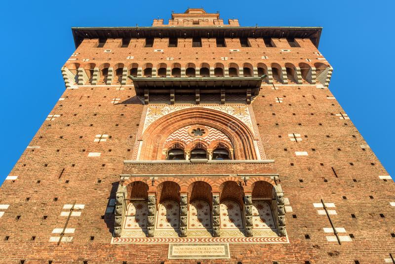 Sforza Castle close-up, Milan, Italy. It is a famous landmark of the city. Bottom view of main tower in summer. Renaissance architecture in the Milan center stock image