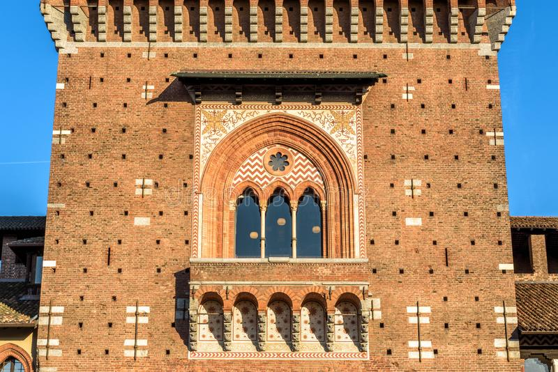 Sforza Castle close-up, Milan, Italy. It is a famous landmark of the city. Detail of main tower Torre del Filarete. Ancient architecture in the Milan center royalty free stock image